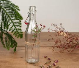 Bouteille en verre pour l'eau, avec bouchon mécanique