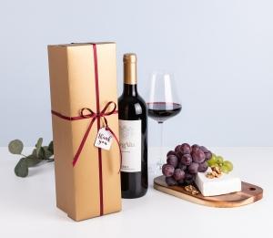 Caja de vino dorada